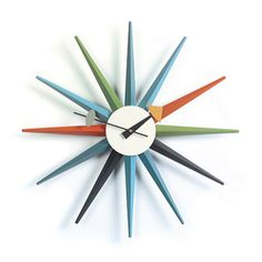The Sunburst Multicouloured Quick Ship Wall Clock was designed in the mid 20th Century by George Nelson and is produced today by Vitra.Manufactured using various woods and metals, this clock will bring a hint of retro style to your living or work space.Contact us now for help, for a personalised quote and to discuss savings for trade and volume purchases