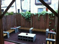 This patio is just awesome. It is so cool looking, it's sturdy, durable, affordable, functional…I am running out of adjectives! I just wish I had more photos of this patio to share with you! They even created the coffee table in the center using cinderblocks. I am thinking they could take it one step further …