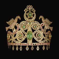 Bird Tiara, Fes Morocco, 20th Century. It is made of rose-cut diamonds, emeralds, and cabochon-cut faceted stones in synthetic red or blue. This tiara is inspired by Andalusian models, especially the time Nazari.