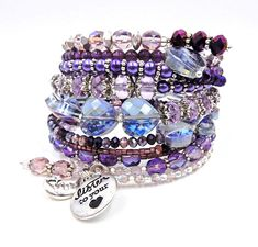 This 10 row memory wire bracelet is made of pretty purples and is filled with various glass beads, glass pearls, crystals, silver spacer beads and bead caps, 3 handmade crystal drops, a silver moon and star charm, and a silver 'Listen to your heart' charm.   ★ Return to my main shop