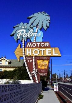 The Palms Motor Hotel crouches behind a neon sign that is perhaps 40 feet tall and 15 feet wide. It features palm trees, monkeys, and a massive yellow illuminated arrow that points you toward the lobby. As a bonus, prospective guests are promised FREE TV. Not to be outdone by The Palms, the nearby Mel's Motor Inn offers wayfarers DIRECT DIAL PHONES and COLOR TV. portland oregon