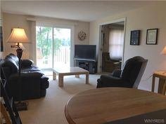 View of living room from kitchen - new sliding glass doors.63 Tralee Ter, Amherst, NY 14051
