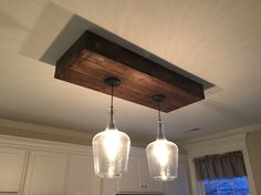 above our kitchen islandhubby made box stained and installed lights allen u0026 roth