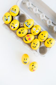 Paint all the eggs yellow and draw each face using paint markers.
