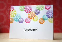 Distress ink emboss resist - with masking (using circle punches) tutorial by Laura Bassen