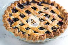 ***My favorite blueberry pie recipe.***An easy blueberry pie recipe with warm spices, lemon and a lattice crust. I make it with 7 cups of blueberries plus 1 cup of sugar.a little more of the rest of the ingredients too. Homemade Blueberry Pie, Blueberry Pie Recipes, Homemade Pie, Frozen Blueberry Pie, Blackberry Pie, Lattice Pie Crust, Pie Crust Recipes, Quiche Recipes, Favorite Recipes