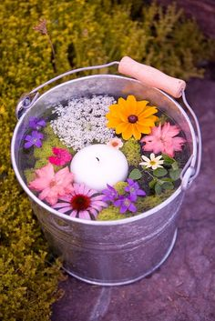 This is my favorite! For a casual surprise, pick colorful flowers and let float them in a can of water. Add a candle too and a few drop of favorite essence if appreciated. kristin60