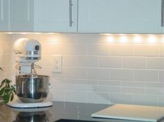white subway tile with white grout backsplash