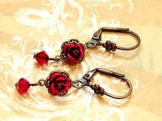 $20 Lovely romantic red flower earrings. Perfect for young girls as well as women who love minimalist earrings. Swarovski Siam crystals. www.rachelsjewelrydesigns,com