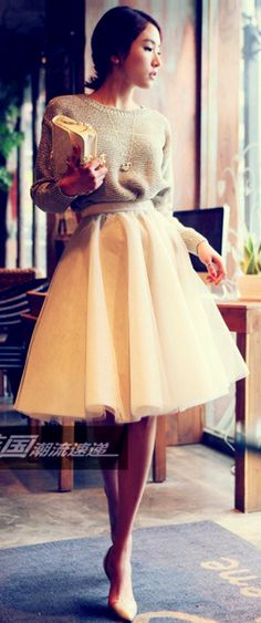 Super stylish for the weekend: comfy sweater + clutch + pale yellow skirt.