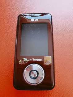 LG chocolate maroon phone(verison version), comes with charger, and one extra battery. Phones, Modern, Trendy Tree, Telephone
