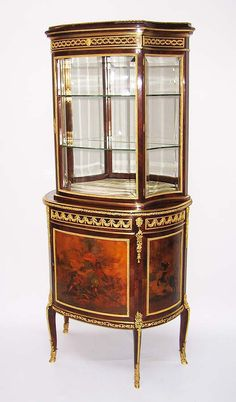A Very Fine French 19th Century Louis XVI Style Gilt-Bronze Mounted Kingwood and Vernis Martin Decorated Vitrine à Deux Corps, probably by François Linke. The lower structure fitted with a frieze drawer and a cupboard door, the vitrine with bevelled front and side glass panels and opening to five glass shelves. Circa: Paris, 1880-1885.