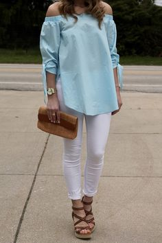 off the shoulder light blue top and white jeans