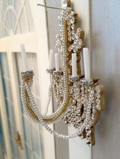 Follow this Chandelier Wall Sconce Tutorial by DollObservers.com member and tutor Jane Reeds: http://dollobservers.com/fashion-doll-tutorials/chandelier-wall-sconce-tutorial