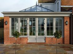 Orangery with brick corners, roof lantern and matching doors / windows. Orangery with brick corners, roof lantern and matching doors / windows. Orangery Extension Kitchen, Orangerie Extension, Kitchen Orangery, Orangery Conservatory, Conservatory Extension, Kitchen Diner Extension, Roof Extension, Extension Ideas, Orangery Roof