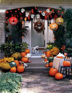 Black Metal Chair with Rich Climbing Plants and Hanging Jack O-lantern with Spooky Flags feat Wonderful Fall Front Porch Decorating Idea