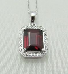 Elegant and classy diamond pendant with a garnet. You can find it at Keswick Jewelers in Arlington Heights, IL 60005