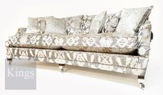 Duresta Hornblower. A most elegant Knole sofa with curved front. www.kingsinteriors.com