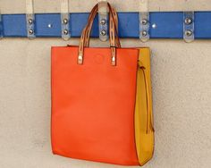 A two-toned bright handbag in the spring is a WOW!!!!!  All women notice handbags and this bright yellow and orange will draw compliments!