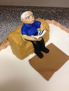 how to make man sitting on a chair with gumpaste