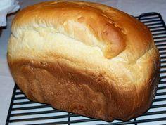 Hawaiian Bread  ¾ cup pineapple juice  1 egg  2 Tablespoons olive oil  2 ½ Tablespoons sugar  ¾ teaspoon salt  3 cups bread flour  2 tablespoons milk  1 ½ teaspoons yeast