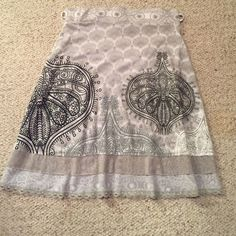 """Desigual midi skirt Desigual midi skirt. Flows fabulously and is very soft! It is missing a shiny 2"""" silver/grey ribbon, that went through the 2 belt loops. My shirt always covered it, so I never had to worry about it. Wore 3-4 times and is in perfect condition. There are 3 tiers at the bottom, but they are sewn together so the skirt moves freely! Grey, silver and navy accents. Desigual Skirts Midi"""