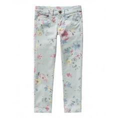 Pantaloni skinny stretch stampati all over vintage effect con quattro tasche: due frontali a filetto e due a pattina chiuse da bottone sul retro. Chiusura frontale con zip e bottone.