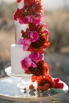 Striking pink and red flowers run down the side of a simple white wedding cake, for a mexican themed wedding. Zombie Wedding Cakes, Wedding Jokes, Wedding Cake Red, Elegant Wedding Cakes, Wedding Cake Designs, Wedding Cake Toppers, Wedding Ideas, Wedding Themes, Wedding Favors