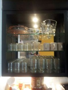 Took off cabinet doors added glass shelves & mirror.  Recycle reuse re- purpose
