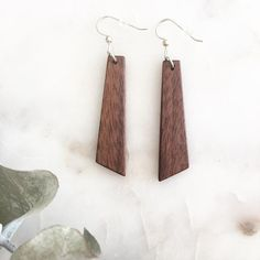 """Handmade by The Lyon Co. for Ava Berry Lane. Our drop earrings are individually shaped, sanded, and buffed with a light coat of our wood butter for added protection. They are lightweight and versatile which makes them the perfect go-to earring for any occasion. Make them the final touch to your favorite look or send them to someone who'd love them as much as you do. All hardware is 925 Silver Each pair includes a gift box Approximately 2 1/2"""" long Made in Texas These earrings..."""