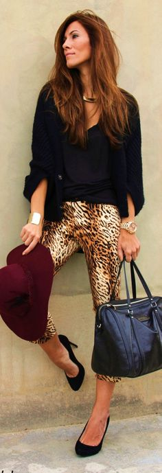 Black tee & oversized sweater, leopard skinnies, black stilettos & awesome bag, Burgundy slouchy brim hat, gold accessories...love the combination of colors