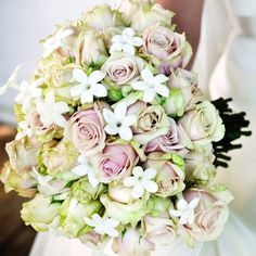 Stephanotis add a whimsical element to this blush rose bouquet.Photo Credit: Donnell Probst Photography