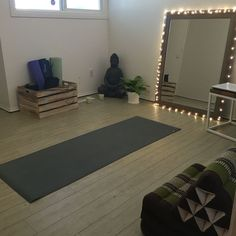 My at home yoga room & meditation room. Ripped up carpets, painted walls & installed so me uberhaus hardwood vinyl tile.