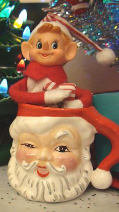 Elf and winking Santa mug: old friends from Christmas past. Photo by beerandrobots on Flickr.