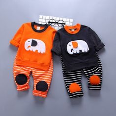 Two-piece fashionable cotton outfit for babies, sizes 12 months to Choose from black or orange. Floppy ears on elephant and patches at the knees. Elephant Applique, Cute Elephant, Dinosaur Outfit, Skull Hoodie, Designer Kids Clothes, Baby Cartoon, Matching Family Outfits, Baby Outfits Newborn, Baby Shirts