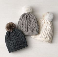 Cable knit beanie hats with faux fur pom poms. Motifs Beanie, Knit Beanie Pattern, Cute Hats, Winter Wear, Kind Mode, Beanie Hats, Baby Beanies, Fur Babies, Knitted Hats