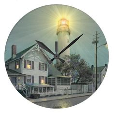 """A beautiful clock by the award-winning artist Paul McGehee. """"Fenwick Island Lighthouse"""" by Paul McGehee. Delaware's famous Fenwick Island Lighthouse, built in 1858, stands on a small peninsula at the Delaware/Maryland border."""