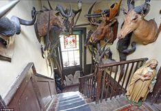 The staircase was installed in Animal heads are mounted on the walls and a religious statue waits at the top. Inside Mansions, Old Mansions, London Mansion, Wisteria Plant, Georgian Mansion, Georgian Interiors, Georgian House, Vintage Interiors, House Interiors