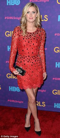 Red on the red carpet: Nicky Hilton added to the glamor of the event with a red lacy dress