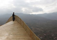This steeply slanted platform forms a roadside market and elevated viewing point for a Chinese town being rebuilt after two earthquakes.