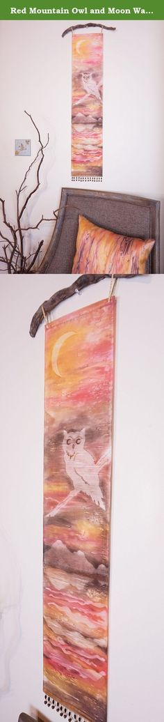 """Red Mountain Owl and Moon Wall Art Tapestry. Misty nature silhouettes float over vibrant, watercolor hues in this unique hanging Art Panel. It is hand painted using a textile pigment on silky fabric, resulting in a subtle texture and shimmer. It measures 8"""" x 36"""", a long narrow painting perfect for small spaces. Delicate loops of ribbon allow it to be hung on a decorative rod or branch, while beaded fringe at the bottom adds a bit of sparkle and weight for a nice drape. Each Art Panel is..."""