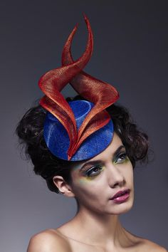I love the sophisticated sweep of the curves on this hat. Lisa Tan Millinery.