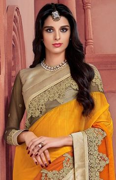 702950 Orange, Yellow  color family Embroidered Sarees, Party Wear Sarees in Crepe, Faux Chiffon fabric with Lace, Machine Embroidery, Stone, Thread, Zari work   with matching unstitched blouse.