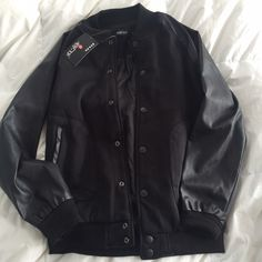 Black Letterman Jacket Leather sleeves jacket, it's like a varsity jacket. Brand new with tags NWT. Super cute!  Brand: N/A Size: Large  Before shipment, ALL items in my closet will be washed, ironed, and lint rolled if needed.   Check out my closet for more cute items!  I ALWAYS discount bundles! Jackets & Coats Utility Jackets