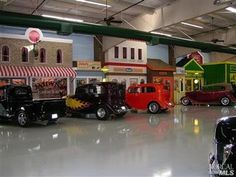 2 of 2 Built around a 1950/60's theme. The building has an exact replica of an old Mobile Oil gas station w/ full-time mechanic, antique gas pumps, famous Mobile Pegasus sign, also charming are the old Downtown America storefronts including a grocery store, Rexall Drugs, Harley Davidson, tackle shop & more...it not only showcases glittering cars but has a full service 1950's Nana's Diner built to honor the memory of where the owner took his wife on dates. Decked out w/ neon signs & soda…