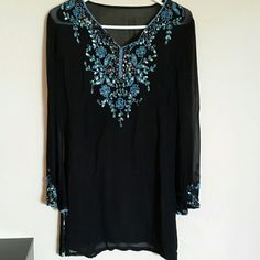 "Beautiful sequin tunic top Preloved beautiful sequin tunic.. Very small pricks on one sleeve hardly noticeable...length is 31"". Tops Tunics"