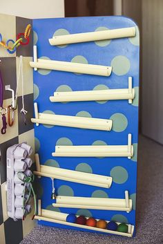 The Ball Ramp Board This was definitely my pride and joy. Inspired by the stupidly expensive Vilac House of Balls toy, I made my own version from PVC pipes and wooden dowels. I think I might actually enjoy playing with this one a lot more than Henry does...