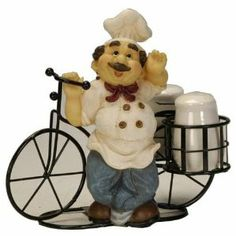 """Mini Ceramic Salt and Pepper Shaker Set on a Cute Chef Metal Bicycle, Bicycle Riding Chef Collection by mtx. $25.00. Guests of all ages will love this sweet chef bicycle.. Dimensions: 8"""" tall by 9"""" long and 5.5"""" wide.. A great housewarming gift.. Bike is made from metal, and shakers from ceramic.. Guests of all ages will love this sweet chef on a metal bicycle with 2 little baskets holding cute Mini ceramic Salt & Pepper Shakers."""