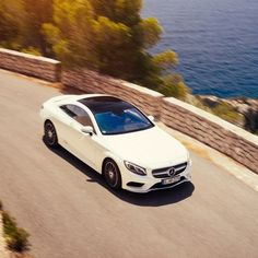 As Ibiza's undulating terrain snakes, rises and dips, the S550 4MATIC Coupe's adaptive logic paces automatic shifting to match any driving style.  #MBphotocredit @rvt3  #Mercedes #Benz #SClass #S550 #Coupe #Ibiza #Spain #instacar #carsofinstagram #germancars #luxury