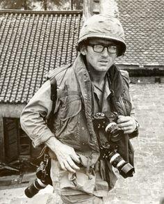 War photographer Dana Stone with three Nikon F-body SLR 35mm cameras